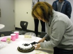 Anne cutting her delicious birthday cake.